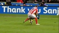 Charlie Adam's wrestling maneuver on Alexis Sanchez